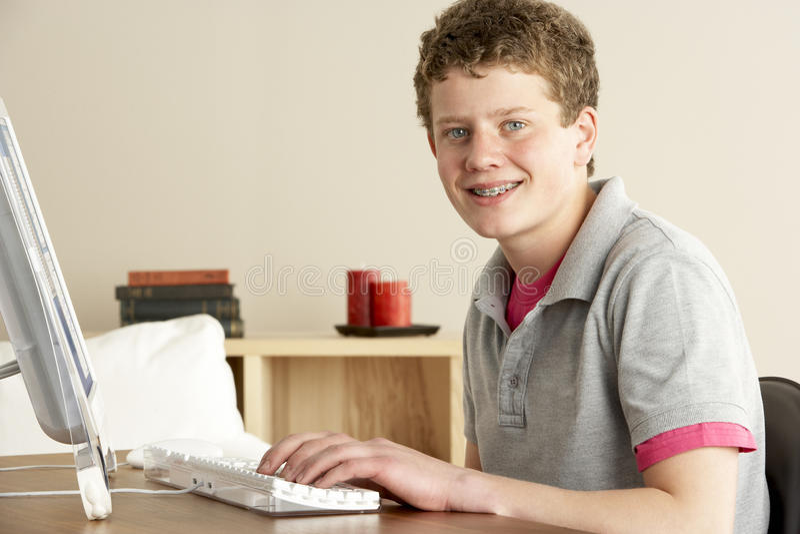 Smiling Teenage Boy Studying at Home royalty free stock image