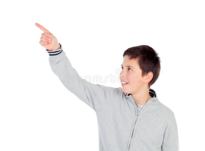 Smiling teenage boy of thirteen indicating something stock images