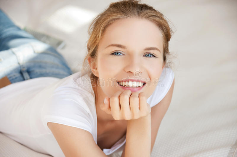 Download Smiling Teenage Girl On A Bed Stock Photo - Image of friendly, bedding: 39515204