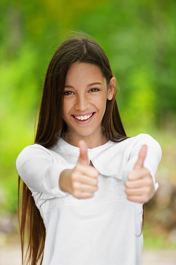 Smiling Teenage Girl Picks Up Big Royalty Free Stock Photo