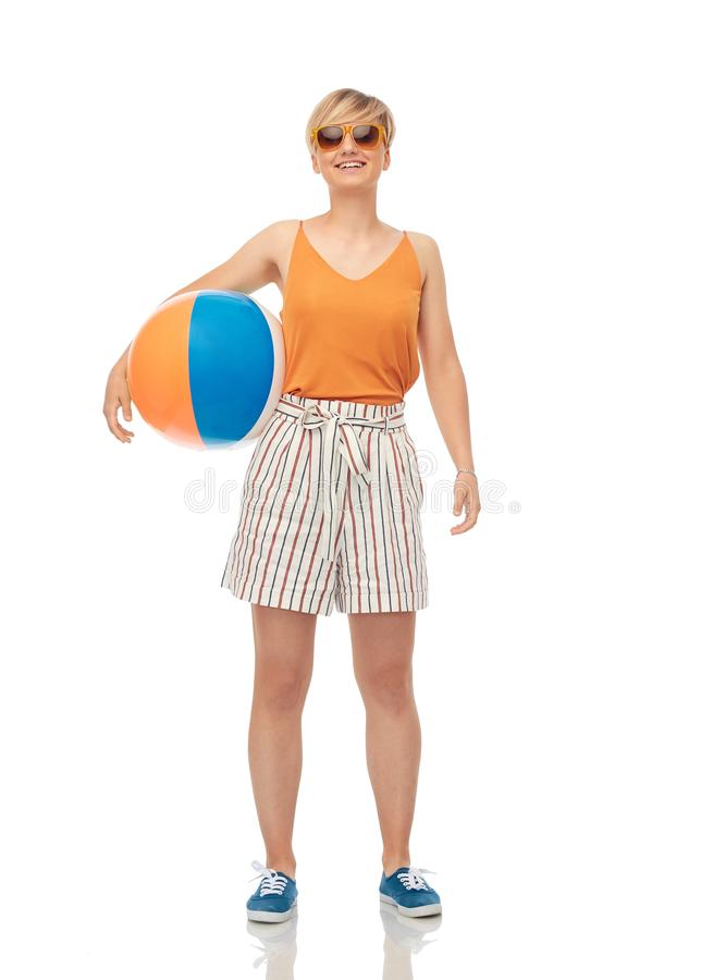 Smiling teenage girl in sunglasses with beach ball royalty free stock photos
