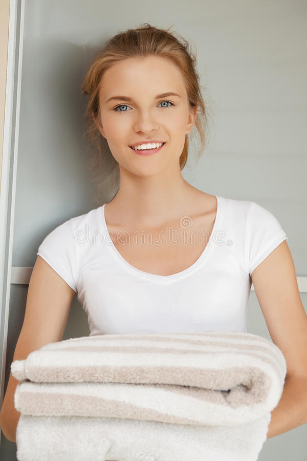 Download Smiling Teenage Girl With Towels Stock Photo - Image of household, indoors: 39513964