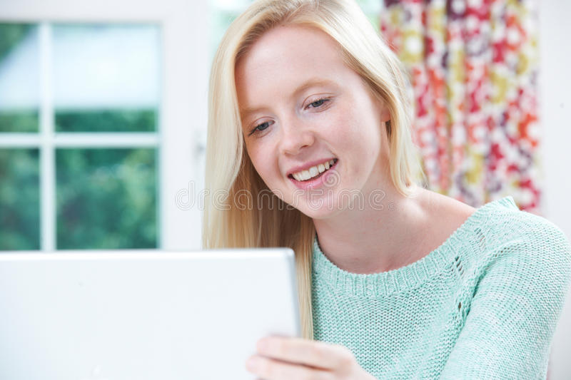 Smiling Teenage Girl Using Computer At Home stock photos