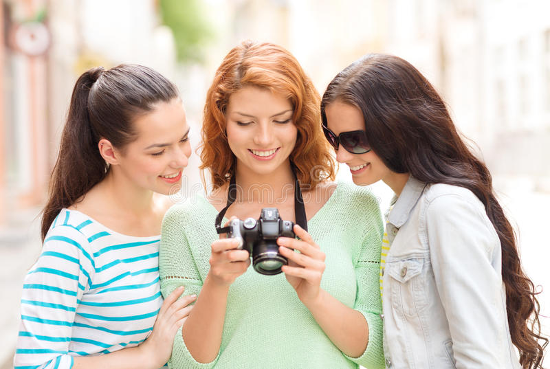 Smiling teenage girls with camera stock image