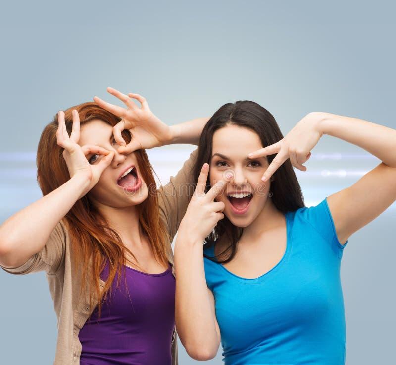 Smiling teenage girls having fun royalty free stock image