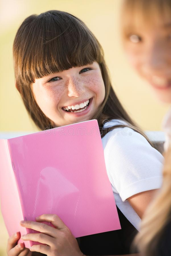Smiling teenager with book stock image