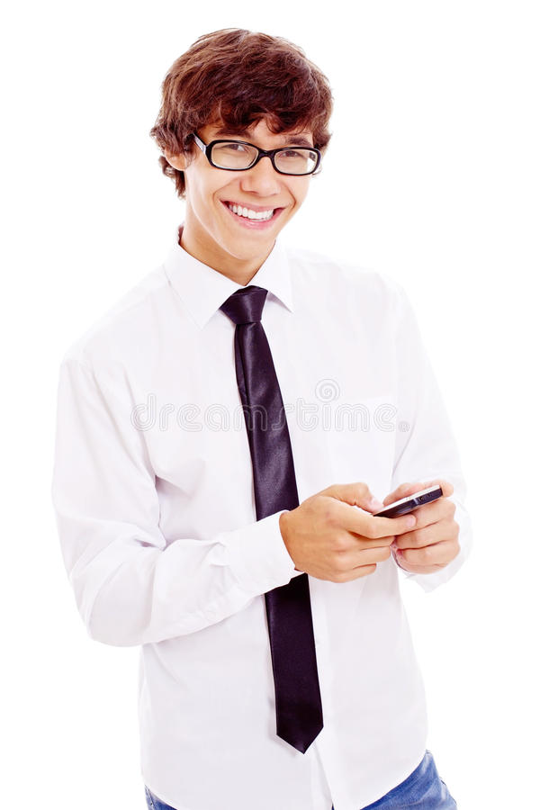 Smiling teenager with cell phone in his hand stock images