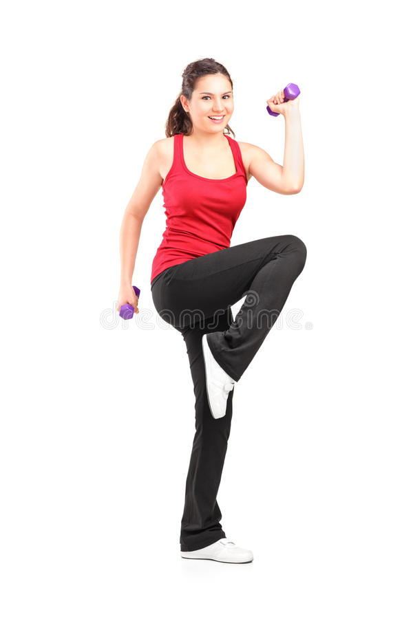 Download Smiling Teenager Lifting Up A Dumbbell Stock Photo - Image: 25334116