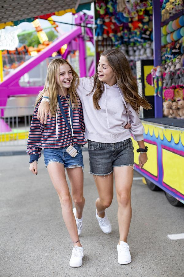 Smiling Teenagers having fun at an outdoor summer carnival stock photos