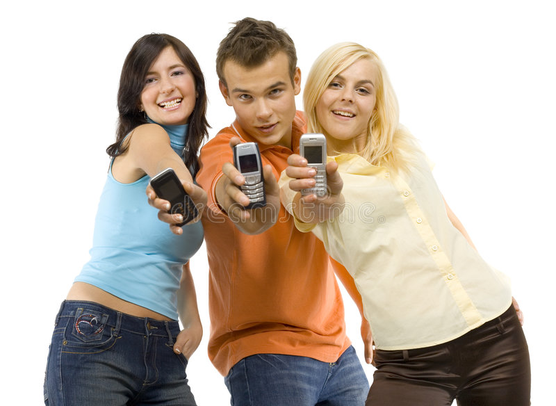 Smiling teenagers with mobiles royalty free stock photography