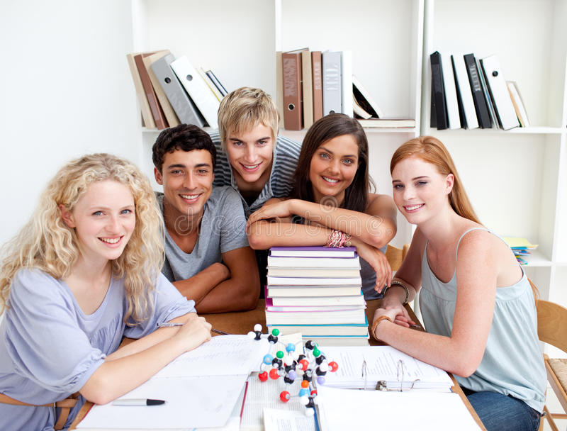 Download Smiling Teenagers Studying Science In A Library Stock Image - Image: 11932991