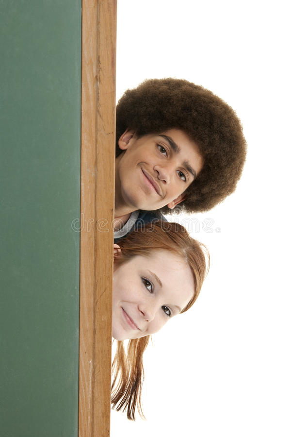 Download Smiling Teens With Blank Chalkboard Stock Photos - Image: 11807503