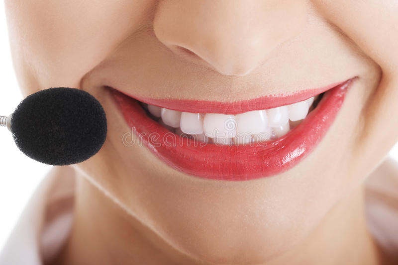 Smiling telemarketing operator with microphone.  royalty free stock photos