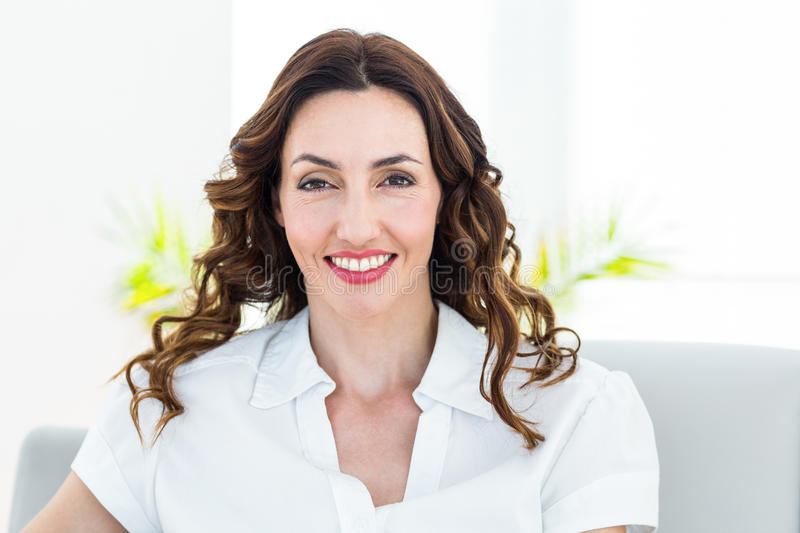 Smiling therapist looking at camera royalty free stock photo