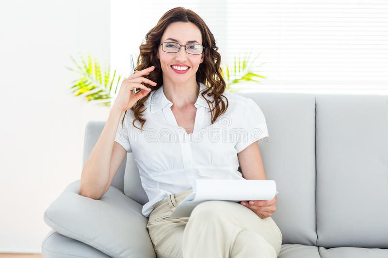 Smiling therapist taking notes royalty free stock photos