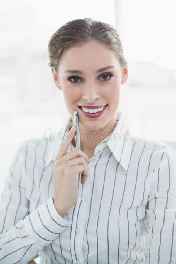 Smiling thinking businesswoman posing looking at camera stock images