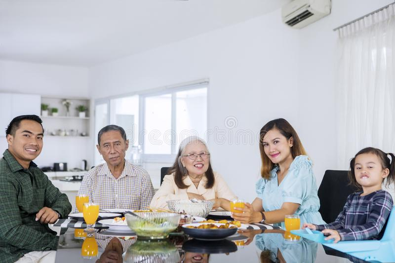 Smiling three generation family having lunch royalty free stock photo