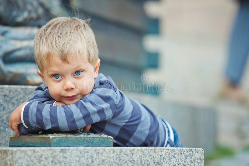 Smiling three year old boy clouse-up portrait. Smiling three year old cute boy clouse-up portrait on town background stock photography