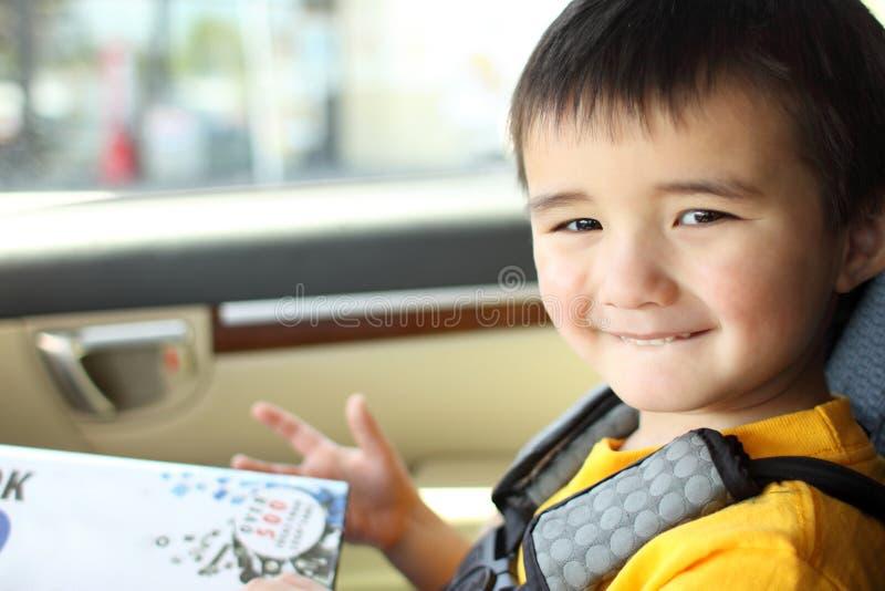 Smiling toddler. Inside a car royalty free stock photos