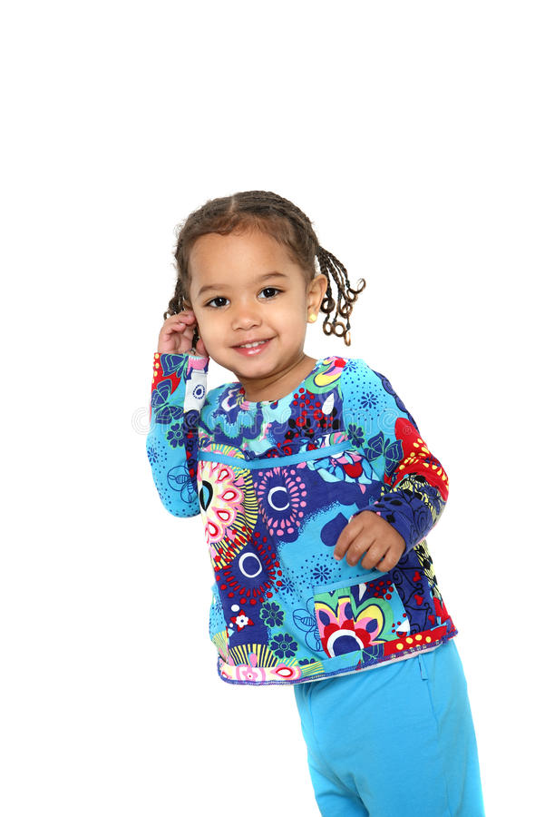 Smiling toddler girl. A happy smiling toddler twirls her hair royalty free stock photo