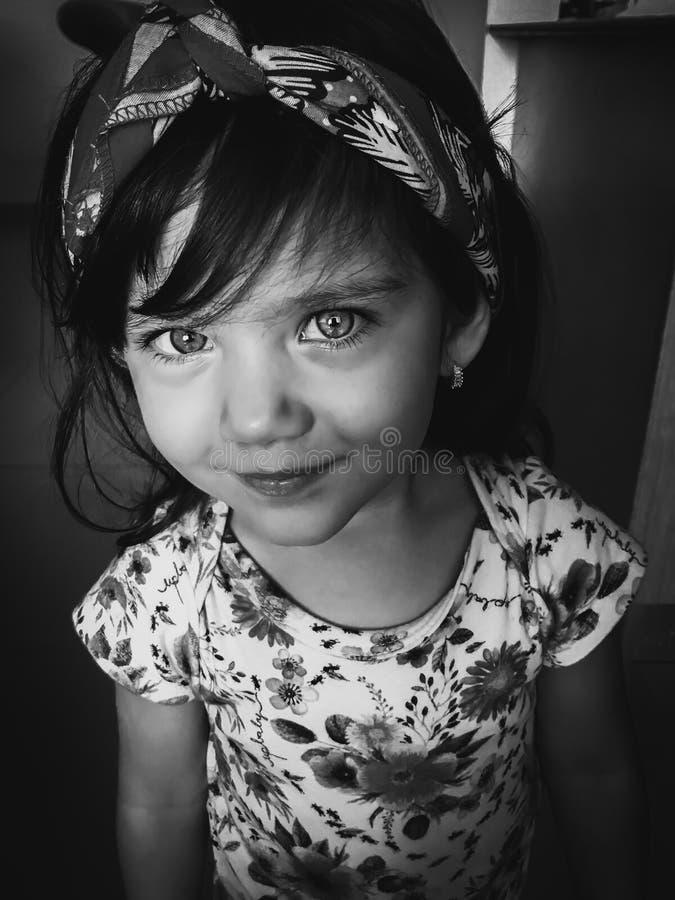 Smiling toddler girl looking at the camera royalty free stock photos