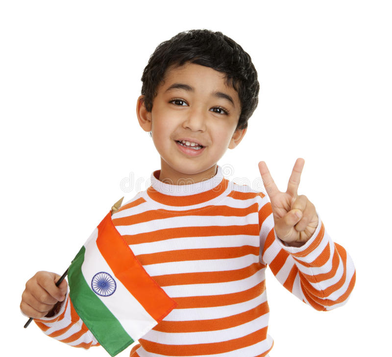 Smiling Toddler Holds Flag of India with a V Sig. Smiling Toddler Holds a Flag of India and Flashes Victory Sign, Isolated, White stock photo