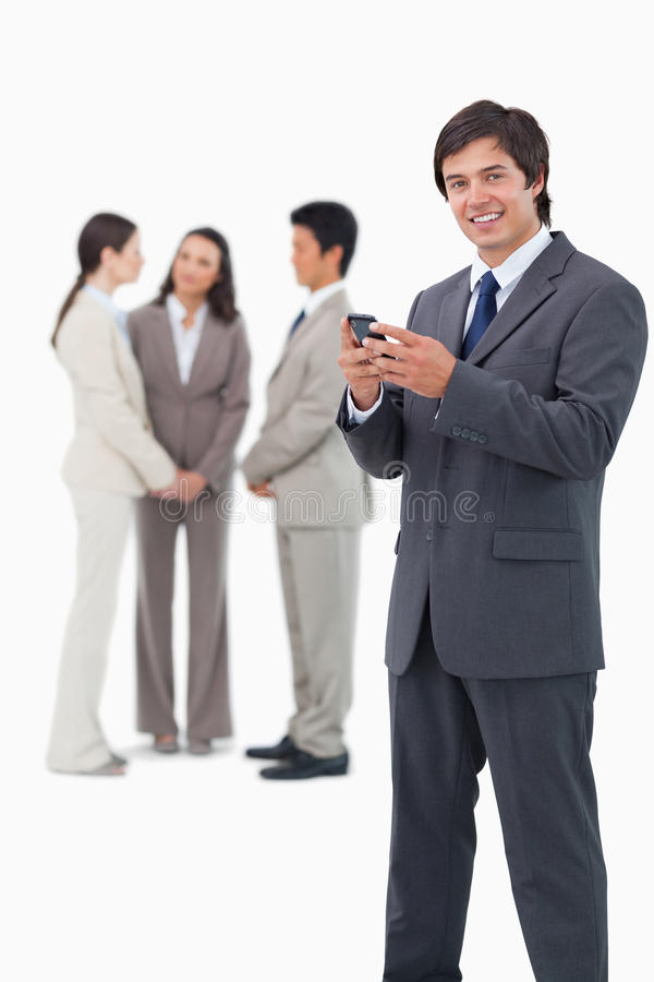 Download Smiling Tradesman With Cellphone And Colleagues Stock Photo - Image of cell, communicate: 22862022