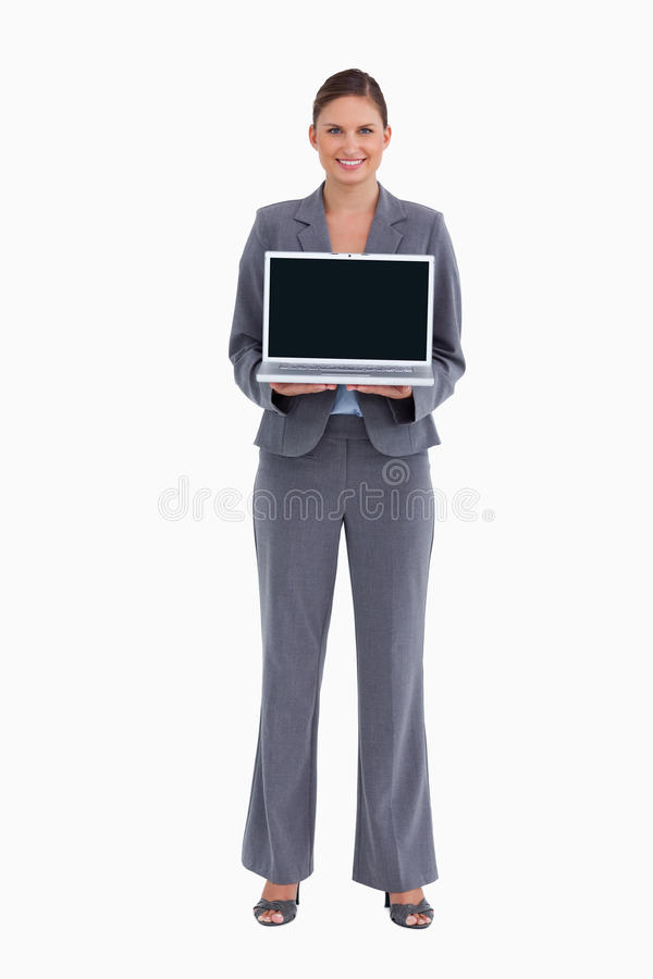 Smiling Tradeswoman Presenting Her Laptop Screen Stock Photography