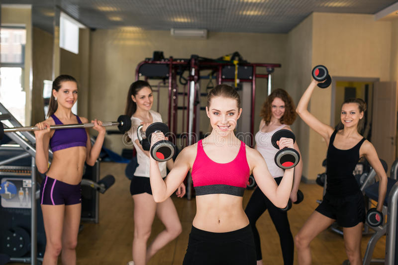 Smiling trainer in front of group stock photography