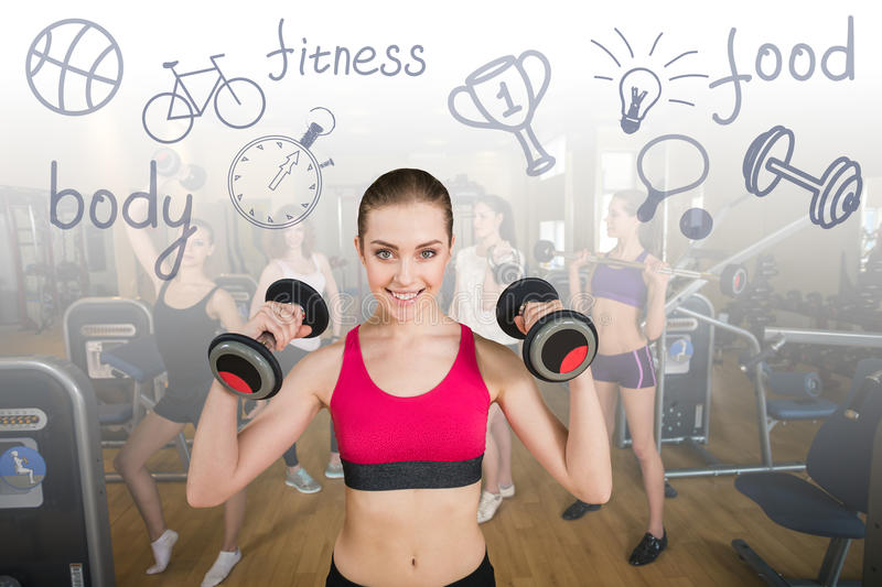 Smiling trainer in front of group stock images