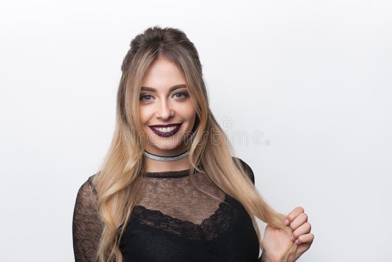 Smiling trendy model on white stock photo