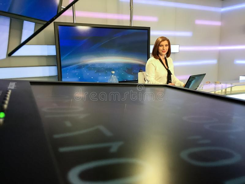 TV reporter at the news desk royalty free stock photography