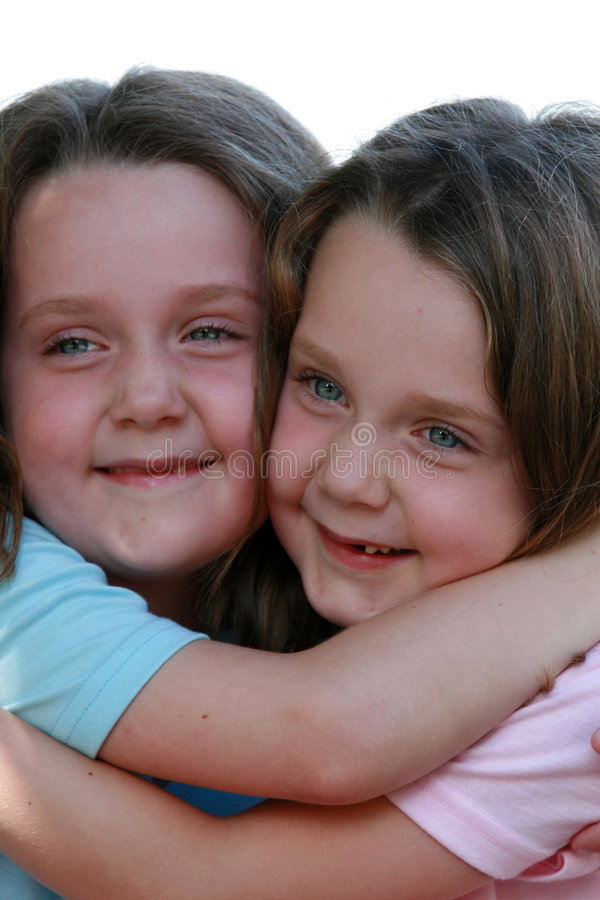 Smiling twins. Two girls - twins royalty free stock image