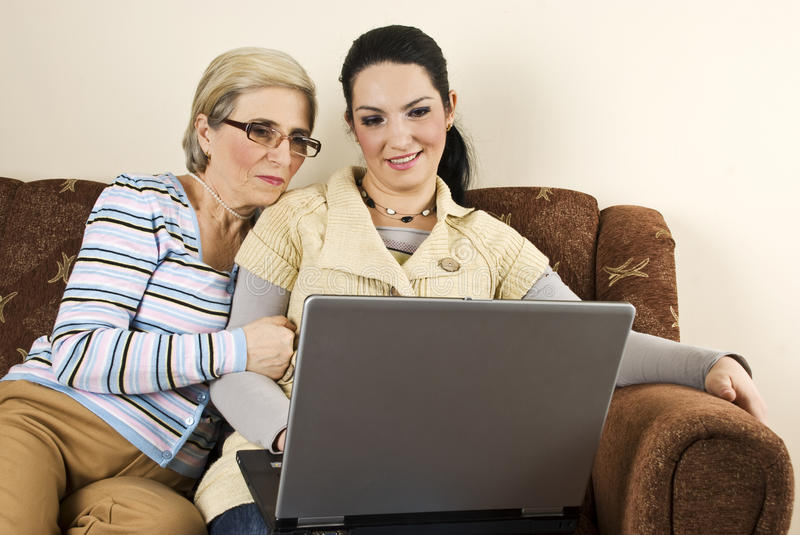Download Smiling Two Women With Laptop Home Stock Image - Image: 12232467
