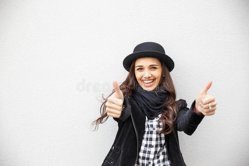 Smiling urban girl with smile on her face. Portrait of fashionable gir wearing a rock black style having fun outdoors in the city royalty free stock photos