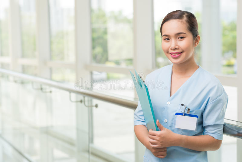 Smiling Vietnamese nurse stock photos