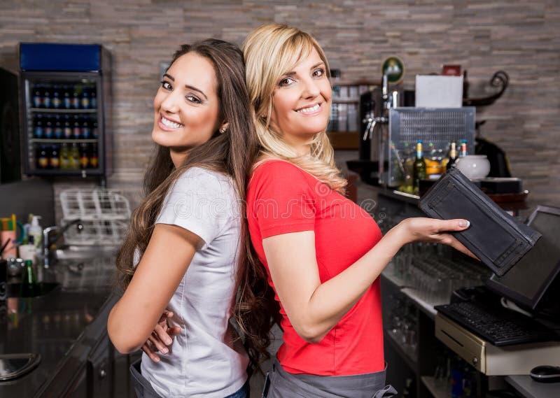 Smiling waitress royalty free stock photos