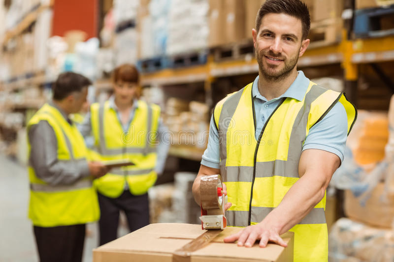 Download Smiling Warehouse Workers Preparing A Shipment Stock Photo - Image of mature, male: 49296630