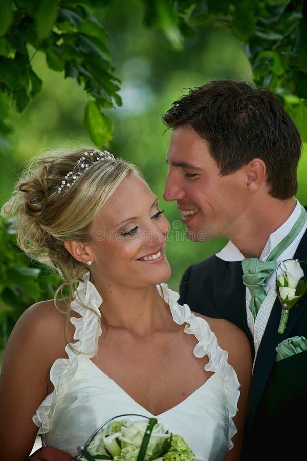 Smiling wedding couple royalty free stock images