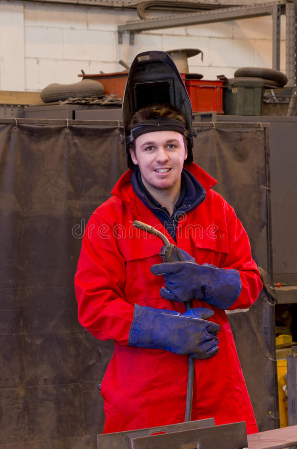 Download Smiling Welder With Safety Visor And Torch Stock Image - Image: 23460615