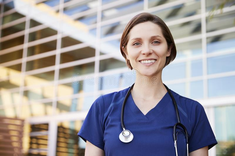 Smiling white female healthcare worker outdoors, portrait stock photos
