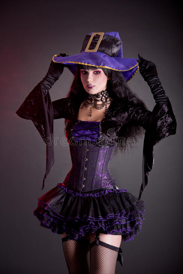Free Smiling Witch In Purple And Black Gothic Halloween Costume Royalty Free Stock Photo - 34389415