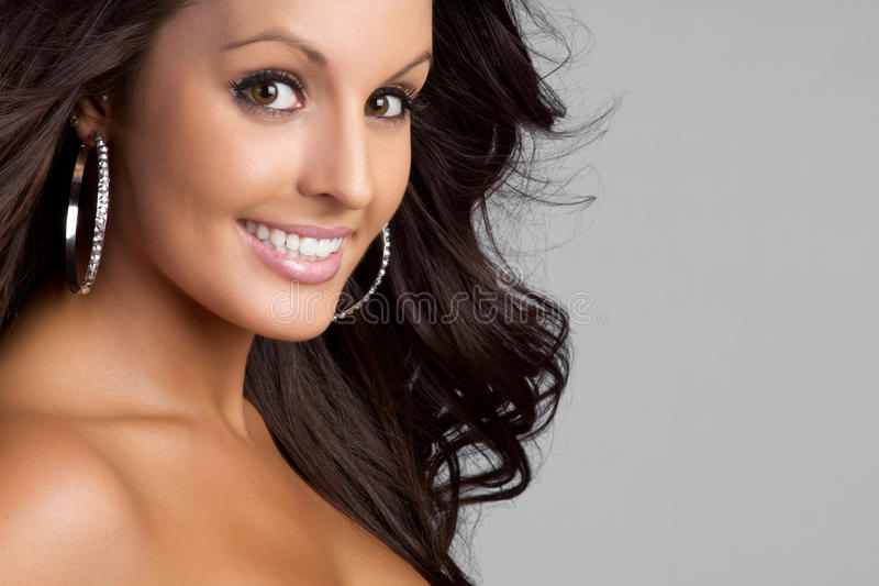 Smiling Woman. Beautiful brown eyes smiling woman royalty free stock photography