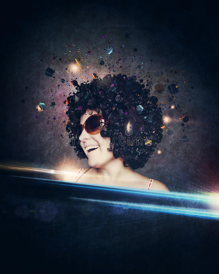 Smiling woman with afro hair listen to music with headphones stock image