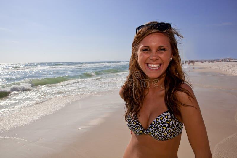 Smiling woman in animal print bikini on beach royalty free stock photography