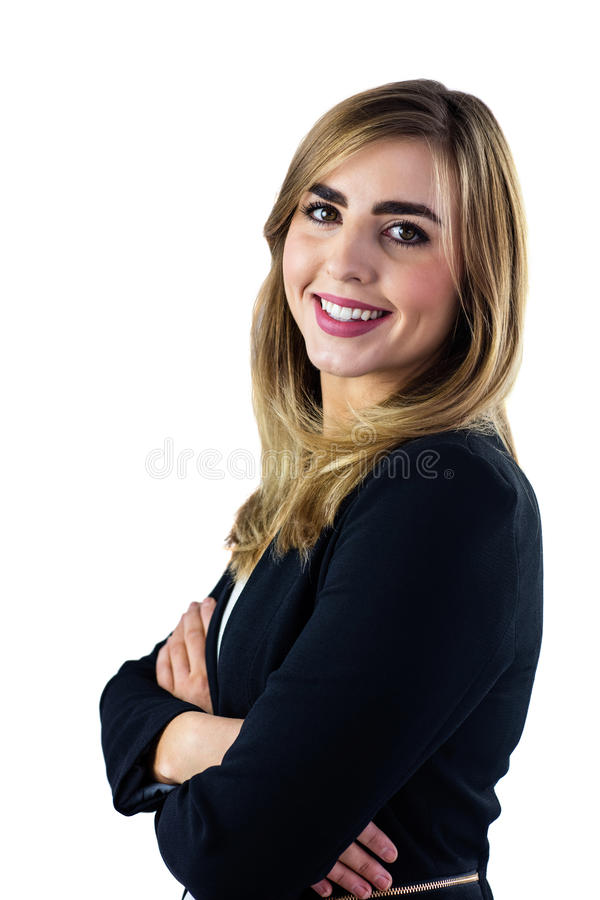 Smiling woman with arms crossed looking at the camera. On white background stock image