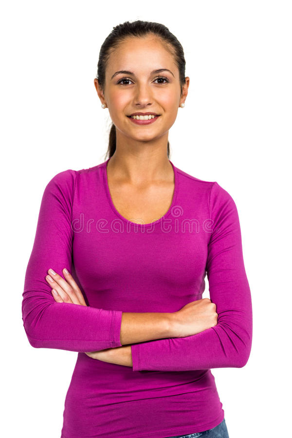 Smiling woman with arms crossed looking at camera. On white screen royalty free stock photography