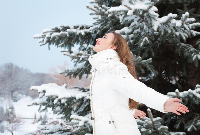 Download Smiling Woman With Arms Raised To The Sky On A Winter Day Stock Image - Image: 28659519