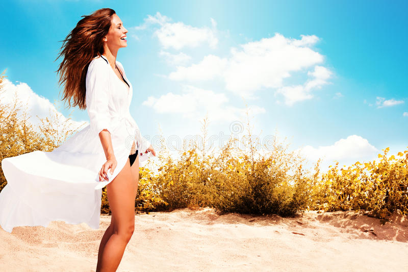 Smiling woman on beach stock photography