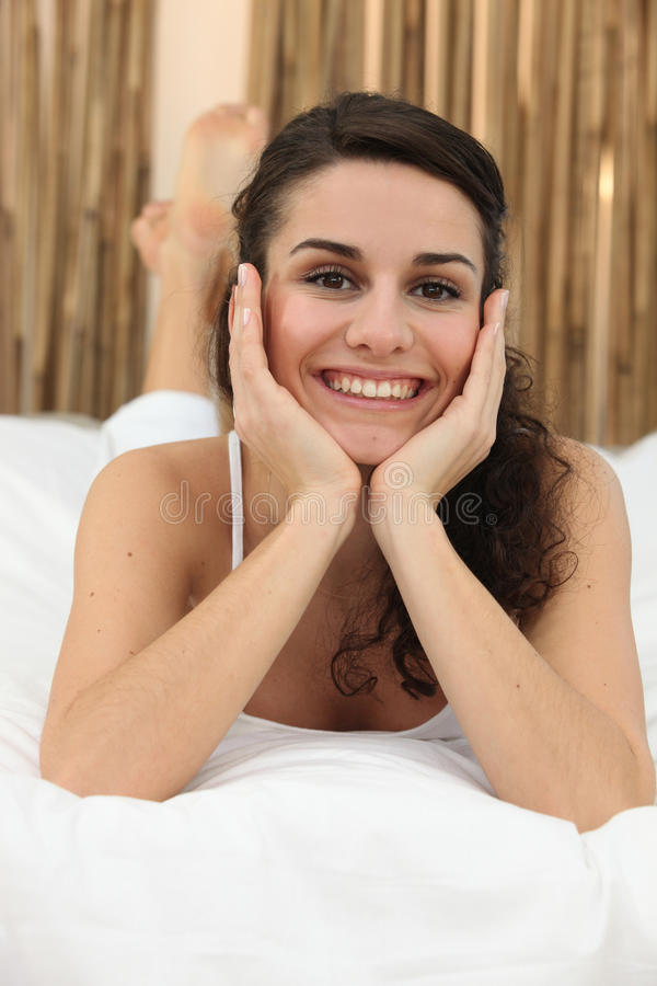 Download Smiling woman in bed stock image. Image of face, beautiful - 23100019